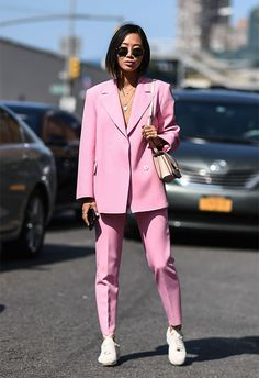Street-styler wearing a pink two-piece suit at NYFW | ASOS Fashion & Beauty Feed
