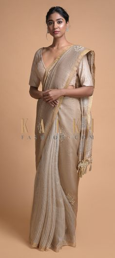 Buy Online from the link below. We ship worldwide (Free Shipping over US$100)  Click Anywhere to Tag Wheat Beige Half And Half Saree In Tussar Silk With Striped Pattern And Gotta Embroidered Motifs Online - Kalki Fashion Wheat beige half and half saree in tussar silk with striped pattern on the pleats.Pallu adorned with gotta patches, zardozi, zari and French knots embroidered motifs in repeat pattern