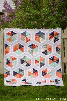 Triangle Hexies PDF quilt pattern – Quilty Love.  Modern hexagon quilt pattern Plays on the popular triangle and hexagon   shapes. No tricky Y seams or paper piecing! Easy construction. An   8inch or larger 60degree triangle ruler is recommended but templates are   provided. Baby, Throw or Twin size Quilt.