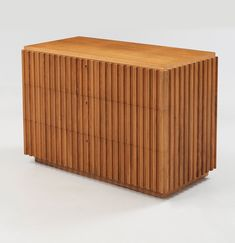 AXEL EINAR HJORTH, OAK CHEST OF DRAWERS, CA 1940.