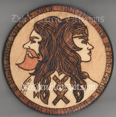 """Frey and Freya by Debra Arnold $25 This is a wood-burning of the Norse God and Goddess Frey and Freya. The runes around them spell: """"Hail Freya. Ruler of Folkvang. Possessor of Brisingamen. Hail Frey. King of Alfheim. Harvest God. Wealth Giver ."""" This is an original design, burned onto a basswood plate/plaque"""