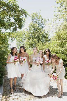 With their bouquets, the bride and her bridesmaids have a jovial moment. PHOTOGRAPHY: Christina Szczupak (@ChrissySzczupak). EVENT FLORALS: Superior Florist (@SuperiorFlorist). CATERER: Abigail Kirsch (@AbigailKirsch).