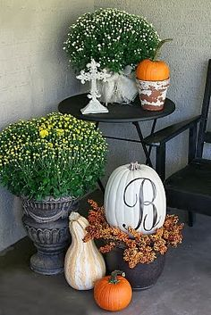 25+ Outdoor Fall Decor Ideas - The Cottage Market. I like the pumpkin in the wreath.