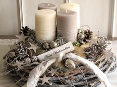 Elaborately designed, natural advent wreath ** ★ Merry Christmas ★ ** The gray limed, large vine wreath was decorated with different colored candles (cream & taupe), which are covered with fur … Christmas Advent Wreath, Christmas Gift Decorations, Christmas Mood, Christmas Centerpieces, Thanksgiving Decorations, Merry Christmas, Advent Candles, Diy Wreath, Christmas Inspiration