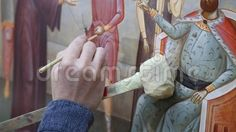Iconographer painting - brush in hand woman and the piece of wood as a support for hand. Iconic Photos, Paint Brushes, Stock Photos, Woman, Painting, Art, Art Background, Painting Art, Kunst