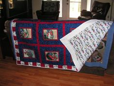 "This is a Christmas quilt that I made using fabric panels intended for a soft book.  The ""pages"" worked perfect for the squares.  It is prints of the nativity scene"