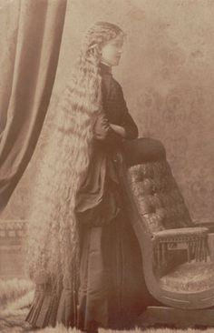 Love the long, flowing locks on this woman! The Photo Detective estimates this photo was taken in the mid-1880s, based on the clothing and arrangement of the background.