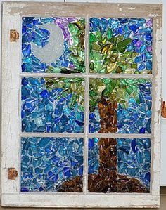 Recycled glass SC Palmetto tree and cresent moon on a reclaimed window. Check out this site to see more fabulous recycled glass art.