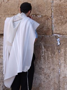 Praying at the Kotel--the Western Wall--in Jerusalem.  A central part of the Jewish experience is to offer prayers at this extraordinary site.