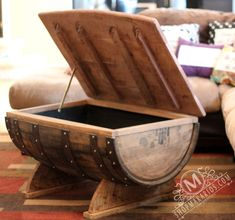 This is a one of a kind coffee table made from a wine barrel and 19th century barn wood! It has a top that opens and closes on a hinge so you can