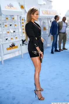 I may need something like this... J.Lo flaunts her long, toned legs in a sexy black skirt suit