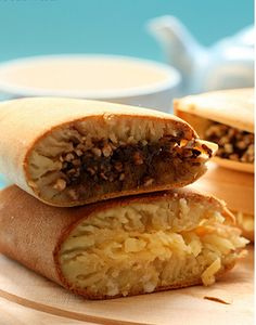 Thick crepes with cheese, chocolate sprinkles and peanuts