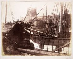 Sailing vessels in harbour, 1845. Salted paper print from calotype negative.