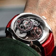 Rarely seen in the wild, here is a casual wristshot of a Cecil Purnell piece unique with a triple axis tourbillon with red accents. ♢…