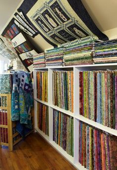 Quilters find green pastures at a well-established shop filled with fabrics and ideas. Bookcase, Quilting, Fabrics, Sewing, Store, Diy, Home Decor, Tejidos, Dressmaking