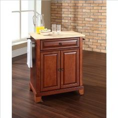 Very pretty and pretty useful, portable kitchen cabinet with granite  top.
