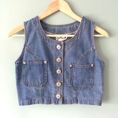 "Vintage Crop Denim Vest Vintage-Inspired medium wash Crop Denin Vest // tag says size 5 (juniors. Could fit women's XS. See measurements) // 16.5"" from armpits / 15"" length / two front pockets // five decorative silver buttons // The Green Box USA brand // non-smoking home ........ 20% off 2+ Bundles // Same Day or Next Day Shipping!! 4.11.13 Green Box USA Jackets & Coats Vests"