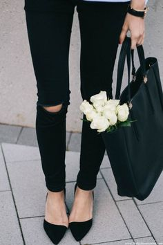black pants with on point shoes and black leather tote bag. Outfit.