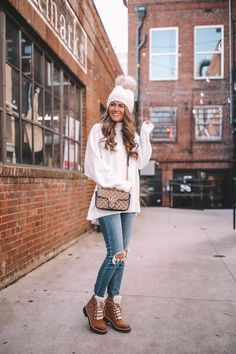 Easy and cozy Turtleneck with distressed denim, Marc Fisher Izzie boots, white pom pom top and Gucci shoulder bag