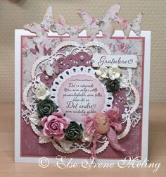 Love the circular layers, the butterfly border sticking up past the edge of the card, the dies used.