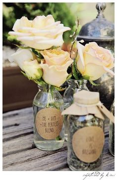 Table centerpiece from Rustic Outdoor Bridal Shower at Kara's Party Ideas. See more at karaspartyideas.com!