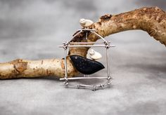 Pin/Pendant by Carolyn Morris Bach featuring Ebony, Cow Bone and Fossilized Ivory $975 @ 123 W. Palace Ave. 505.986.0440