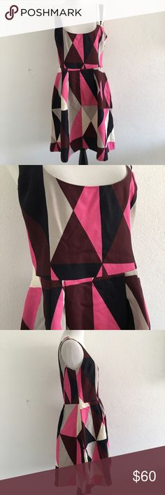 Marimekko Geometric Cocktail Dress Size 38 / 8 US Pre-owned authentic Marimekko Geometric Cocktail Dress Size 38 / 8 US. Has small specs of stain in back shown in picture. Back zipper closure. Please look at pictures for better reference. Happy Shopping! Marimekko Dresses