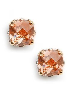 Oversized glass stud earrings in a feminine hue are the prettiest understated accent.  Glass cushion cut stones in a rich champagne hue are set in a gold-tone base.