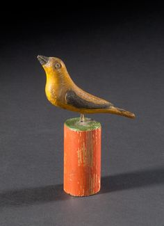 """""""Schtockschnitzler"""" Simmons(Berks County, Pennsylvania, active 1885-1910), carved and painted bird on typical stand."""