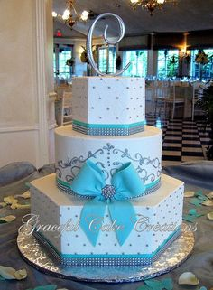 No bow, a teal color and add red flowers down the side and this would be perfect