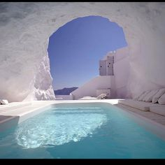 Swimming in a pool inside a cave. Santorini, Greece
