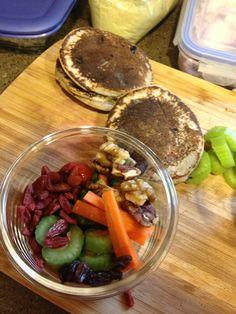 Peanut Butter Pancake sandwich celery with peanut butter goji berries, raisins,  walnuts, peacans snap peas, carrots