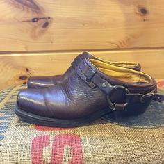 Frye harness mules.  Size 9-1/2 These are awesome Frye mules.  Made in the USA.  Timeless shoes that will last!  Size 9-1/2. The toes have some scratches.  The straps on the heel are a little loose and slide down.  Just need to add a hole in the leather strap. Frye Shoes Mules & Clogs