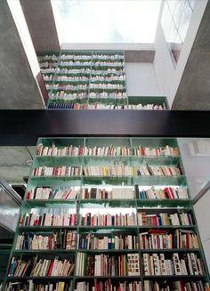 2 story glass bookshelf forms a wall for House in Bordeaux (OMA) / Maarten van Severen
