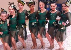 """Mackenzie Ziegler, Maddie Ziegler, Chloe Lukasiak, Nia Frazier, Paige Hyland, Kendall Vertes, and Brooke Hyland in their costumes for """"Money Is The Root Of All Evil"""""""