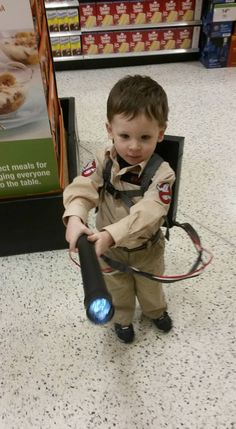 Ghost Buster Costume! A handmade proton pack with flashlight, a tan shirt (Amazon) with iron on patches from eBay and nametag from eBay. some tan pants and a belt make it look like a jump suit. Total $38 Toddler costume, toddler cosplay, ghostbuster