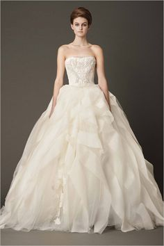 """Vera Wang 2013 Bridal Collection Vera Wang described her Fall 2013 bridal collection, titled All About Lace, as a """"study in femininity and romance [that] celebrates the wedding gown in a new take on classicism and ornamentation."""""""