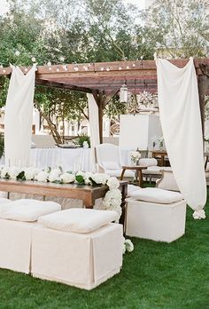 Brides.com: . A white lounge area with bench seating and armchairs.