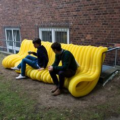 """Street Furniture,"" a series of guerilla public seating areas that sprouted into being through the wrapping of yellow drainage pipes around Hamburg's existing urban infrastructure."