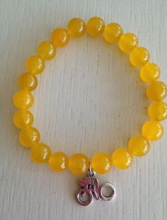 BRAND NEW yellow jade stone Conquer Cancer bracelet with sterling silver cycling charm $39.95 Replace the yellow plastic band with a gorgeous bracelet that is good quality and meaningful  $10 from the sale of each bracelet goes to the Conquer Cancer Ride Charity Event www.enjoyjewellery.com.au
