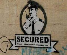 26. Secured (by sleepy migrant workers on minimum wage) - Banksy's critique of both immigration and employment policies.