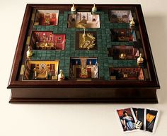 Here is a premiere edition of Clue that has real 3D rooms. It uses the traditional room of course. I want this.