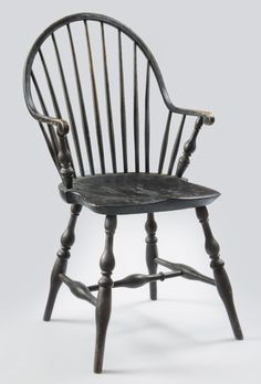Black-painted Windsor continuous armchair with rare scrolled arm terminals Rhode Island, circa 1795 White oak, white pine, and maple, in pri...