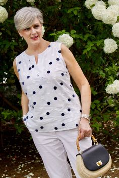 beth from Style at a Certain Age wears a gingham jean jacket, polka dot top, white chinos and wicker handbag White Chinos, Summer Handbags, Fashion Over 50, Blouse Designs, Spring Fashion, Ideias Fashion, Fashion Dresses, Stylish Dresses, Modest Fashion