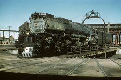 UP Roundhouse - September, 1957 -  Union Pacific Steam 4-6-6-4, Challenger X3941, rolls off the table at Cheyenne.