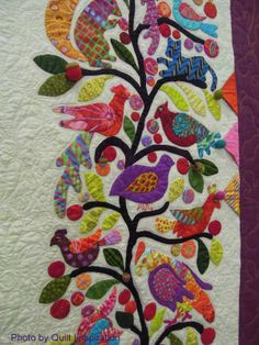 close up, Extravagant Nature by Laura Steineger, adapted from Kim McLean's Roseville Album pattern.  Kaffe Fassett fabrics.  Highlights from the 2014 Tucson, Arizona Quilt Fiesta
