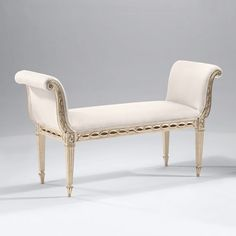 Neoclassic style carved wood bench with antiqued white finish, antiqued silverleaf trim and black muslin upholstery. Made in Italy