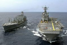 USS Saipan LHA2 during a refueling operation. Yep, this is how ships are refueled.