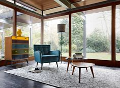 From far left: Roche Bobois cherry-wood and linden Jim linen chest by Jean-François Marchou, £2,800; beech and cotton Sofia armchair by Studio Roche Bobois, £2,370; walnut Jules cocktail tables by Jean-François Marchou, from £690