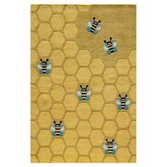 Rug with honeycomb and bee motif.  Product: RugConstruction Material: AcrylicColor: Honeycomb goldNote: Please be aware that actual colors may vary from those shown on your screen. Accent rugs may also not show the entire pattern that the corresponding area rugs have.